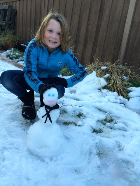 Kennedy and her snowman - Simple Sojourns